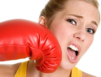 woman getting punched with red boxing glove