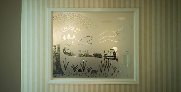 painting with a white frame on a yellow and white wall